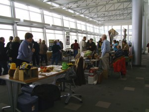 Participants look over displays in a past Winter Gardening Fair at Kirkwood Community College in Cedar Rapids. (photo/Cindy Hadish)