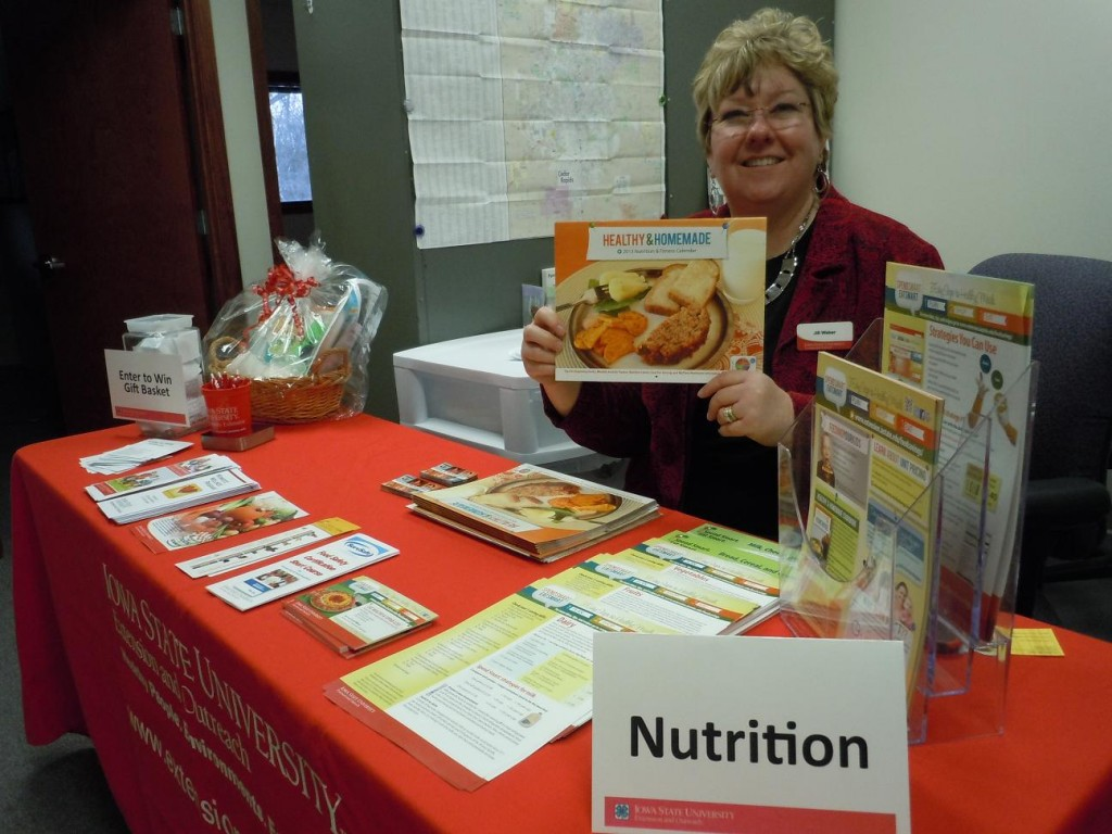 Nutrition program specialist, Jill Weber, is shown at the nutrition table during the open house. (photo/Cindy Hadish)
