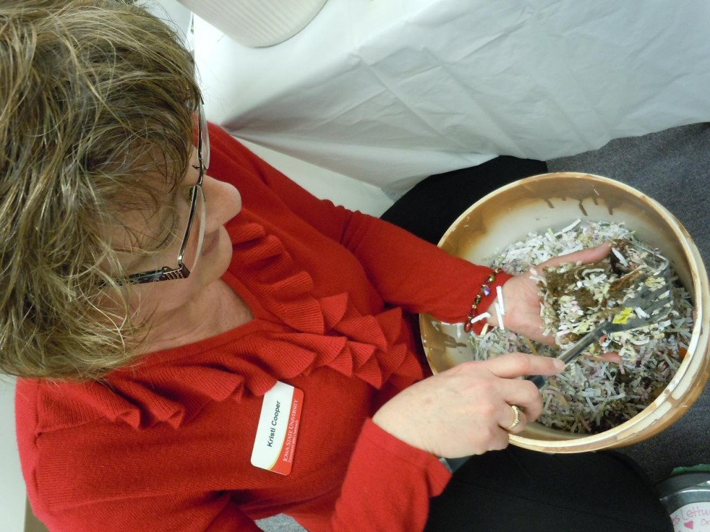 Family Life Specialist, Kristi Cooper, shows how a 5-gallon pickle bucket was transformed into a worm compost bin at the Linn County ISU Extension & Outreach open house. (photo/Cindy Hadish)