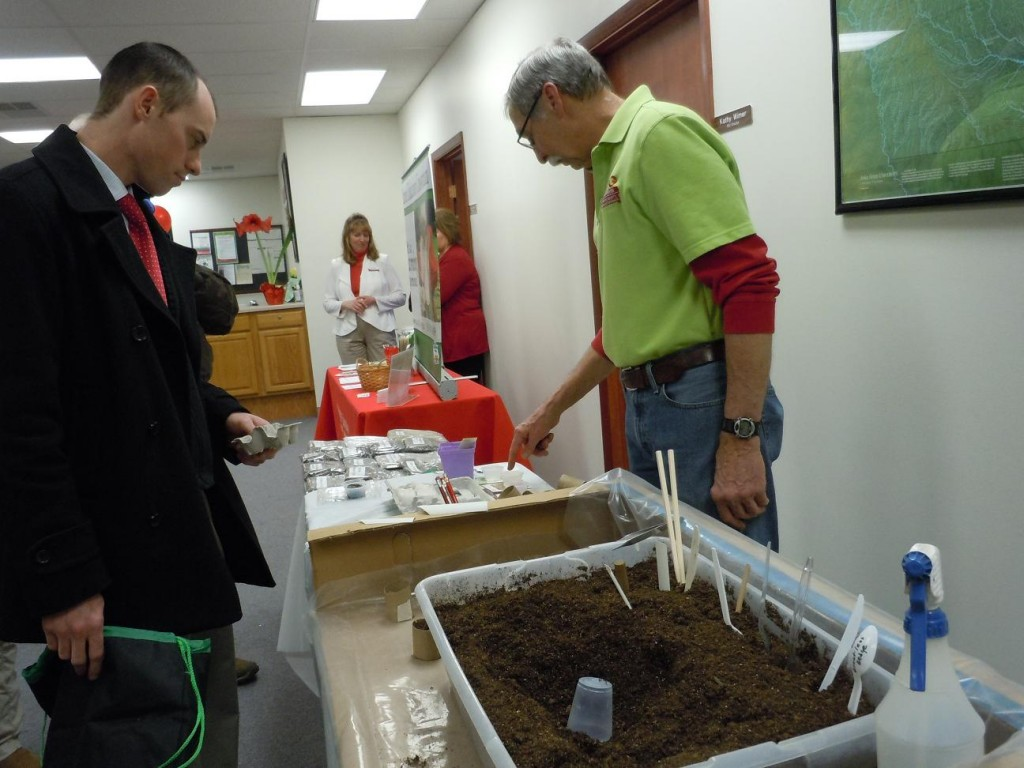 Linn County Master Gardener Phil Pfister, right, points out a selection of seeds to plant during the open house on March 25, 2013. (photo/Cindy Hadish)