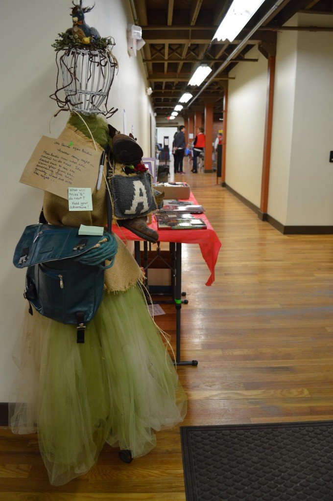 Environmental displays and a used book sale were among the attractions inside the Cherry Building during Eco-Fest 2013 in Cedar Rapids, Iowa. (photo/Cindy Hadish)