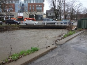 Ralston Creek rises during today's rainstorm in Iowa City. (Photo/New Pioneer Food Co-op)