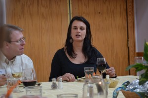 """State Senator Rob Hogg listens to Julia """"Butterfly"""" Hill during a dinner at Prairiewoods. (photo/Cindy Hadish)"""
