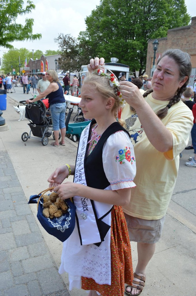 Julie Wiedner of Cedar Rapids fixes her niece's crown before the Parade of Kroje on Saturday, May 18, 2013, during Houby Days in Czech Village. (photo/Cindy Hadish)
