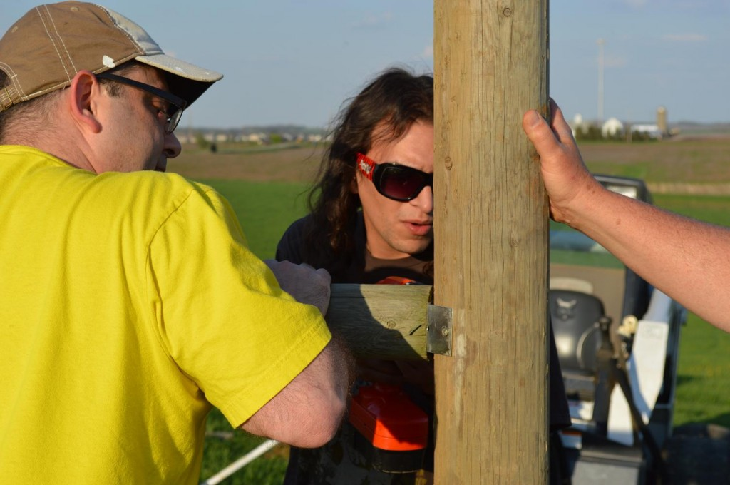 Teamwork helped, as the cross post was checked with a level and drilled into an upright post. (photo/Cindy Hadish)