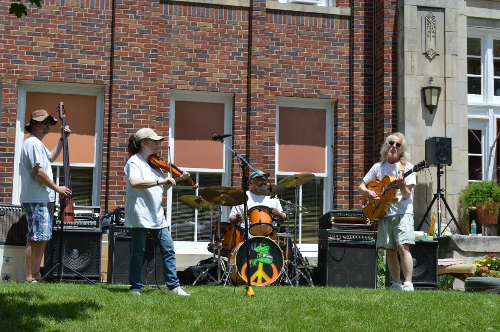 James Kennedy & Friends performs Saturday, June 1, outside the First Street Community Center in Mount Vernon, Iowa. The performance was one of the events during the Mount Vernon Chocolate Stroll. (photo/Cindy Hadish)