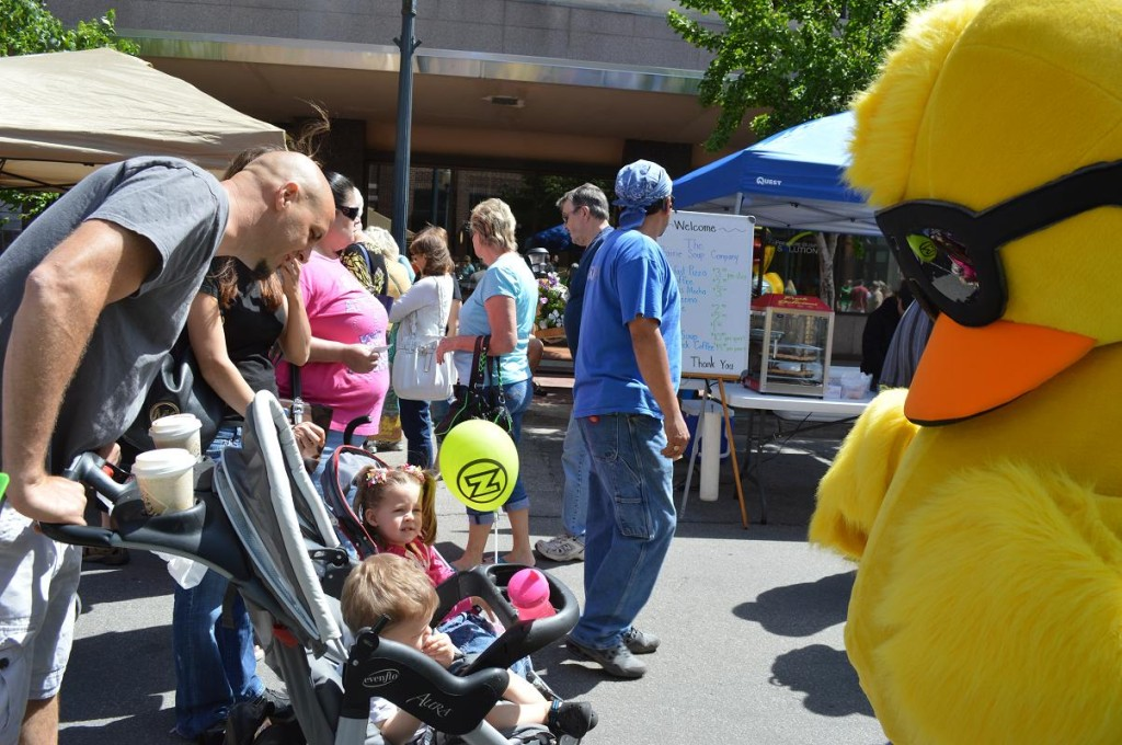 The Great Eastern Iowa Duck Race was promoted during the Downtown Farmers Market. The fundraiser will be Saturday, June 15, 2013, at the Second Avenue Bridge in Cedar Rapids. (photo/Cindy Hadish)