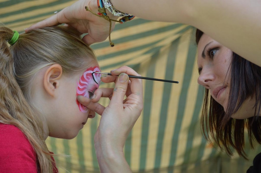 Willow Geoghagan, 5, of Homestead, has her face painted during the Mount Vernon Chocolate Stroll. (photo/Cindy Hadish)