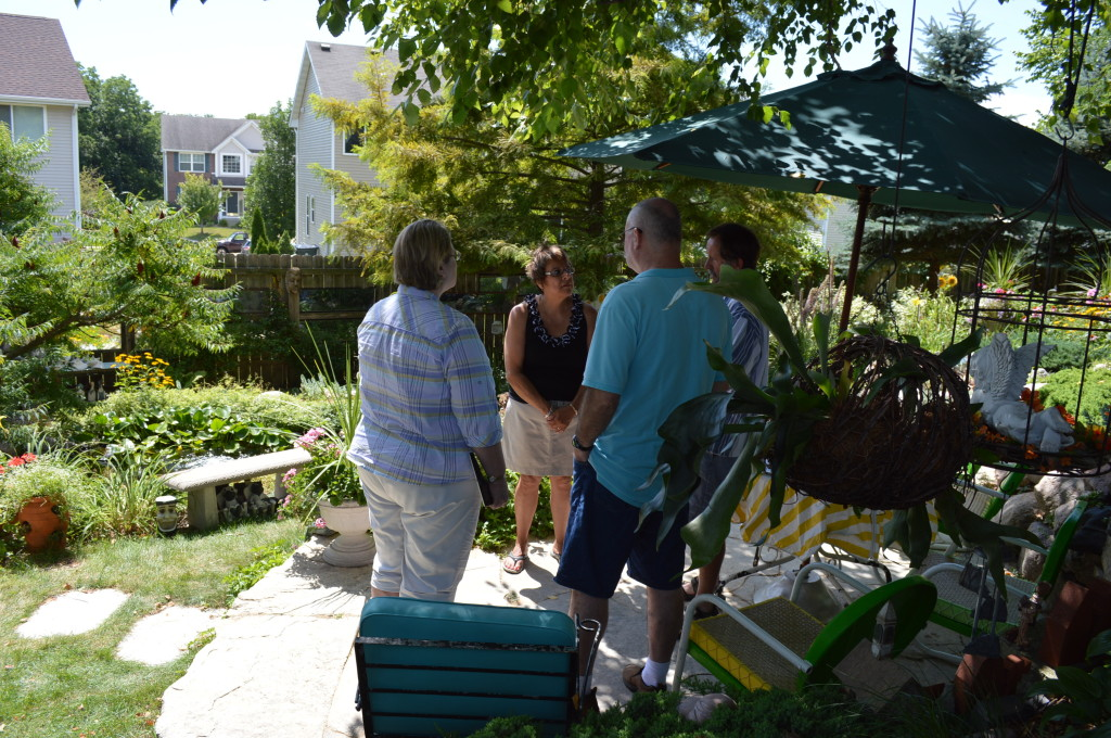 Monica Morley, center, discusses her gardens during Koi for a Cause, a benefit for HACAP. (photo/Cindy Hadish)