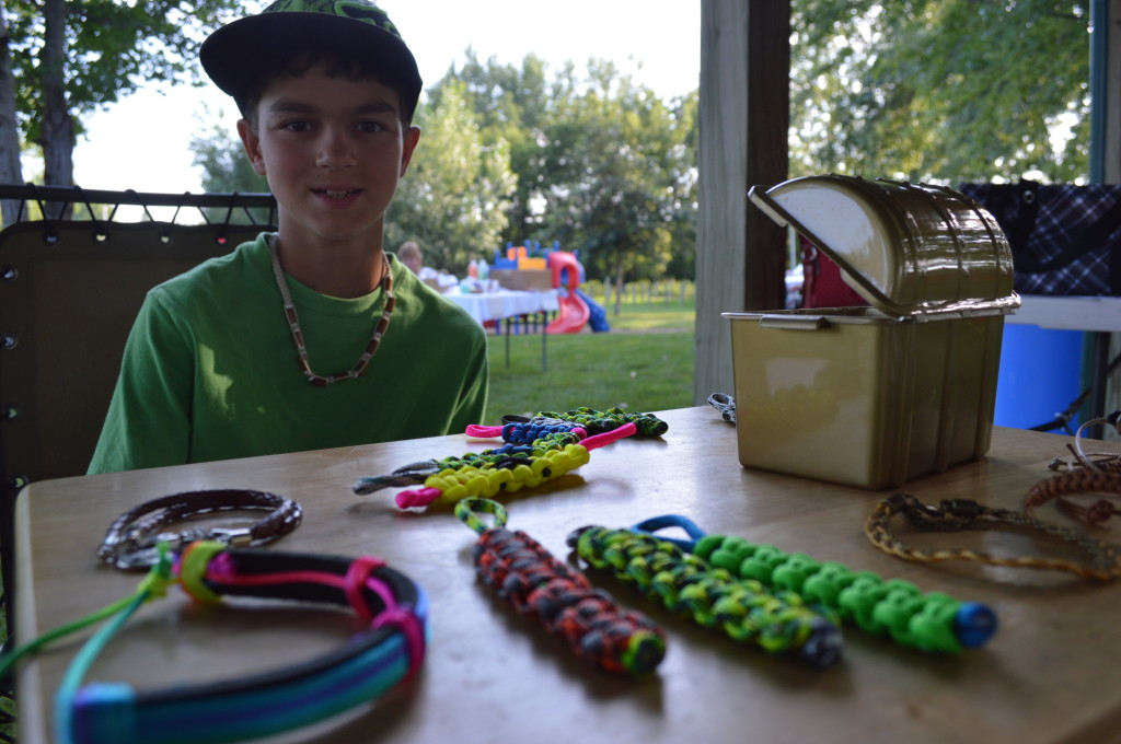 Kyle Scatena, 10, sells bracelets during the Oxford Farmers Market at Creekside Park. (photo/Cindy Hadish)