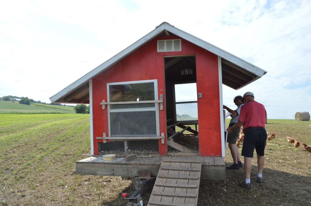 Visitors examine a chicken coop during the field day at Abbe Hills Farm on Sunday, Aug. 4, 2013. (photo/Cindy Hadish)