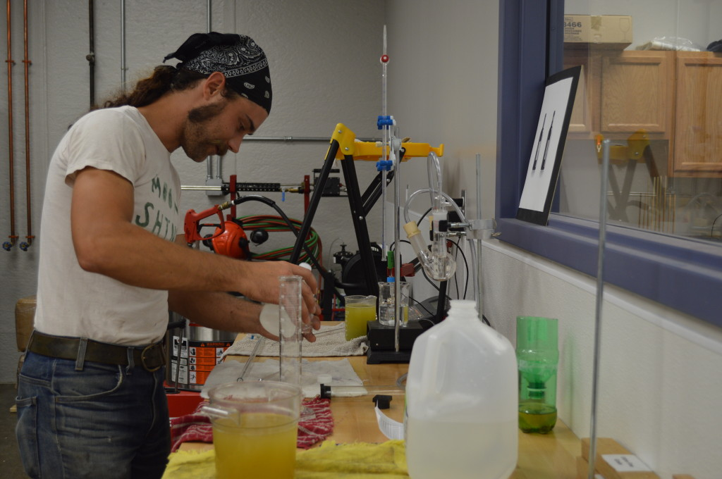 Viticulture instructor, Lucas McIntire, handles the chemistry portion of wine-making during class at Kirkwood Community College in Cedar Rapids. (photo/Cindy Hadish)