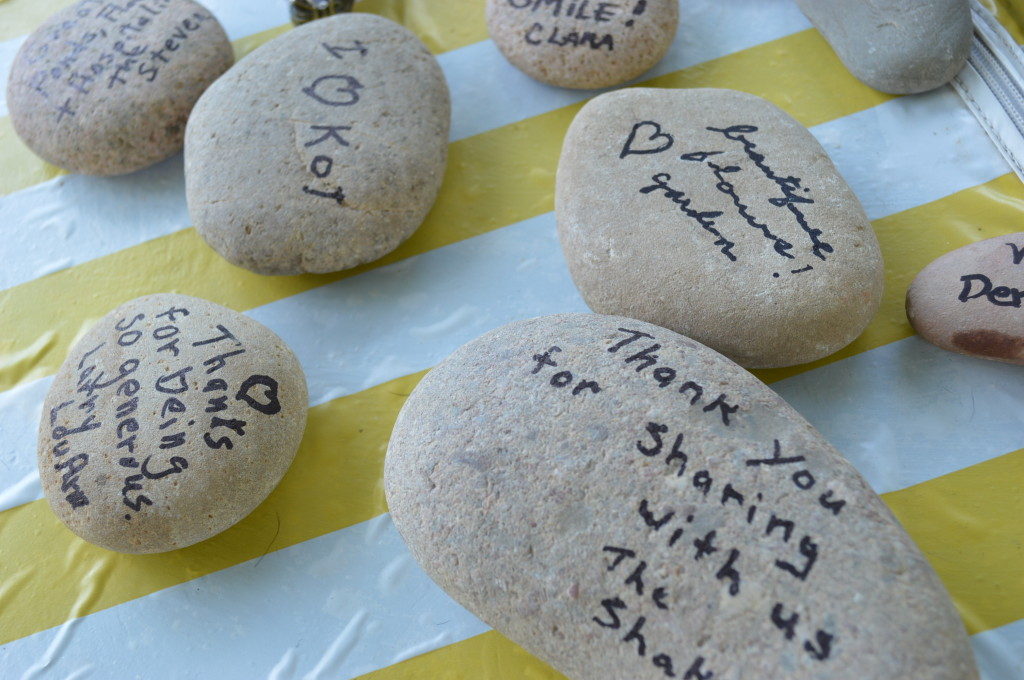 Visitors to Koi for a Cause wrote messages on stones that will be displayed in the gardens in northeast Cedar Rapids. (photo/Cindy Hadish)