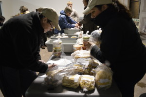 Food is sorted during an Iowa Valley Food Co-op distribution day earlier this year at its former site. The co-op moved this month to a new location at . (photo/Cindy Hadish)