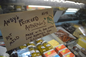 Handwritten signs take note of the local foods sold at Henry's Village Market. (photo/Cindy Hadish)