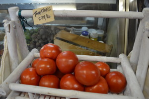 In-season tomatoes are among the items sold at Henry's Village Market in Homestead, Iowa. (photo/Cindy Hadish)