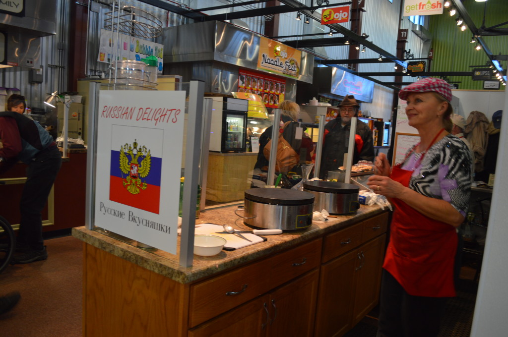 Tatyana Kieler, co-owner of Russian Delights, serves customers Feb. 22, 2014, one of the last days at the NewBo City Market. (photo/Cindy Hadish)