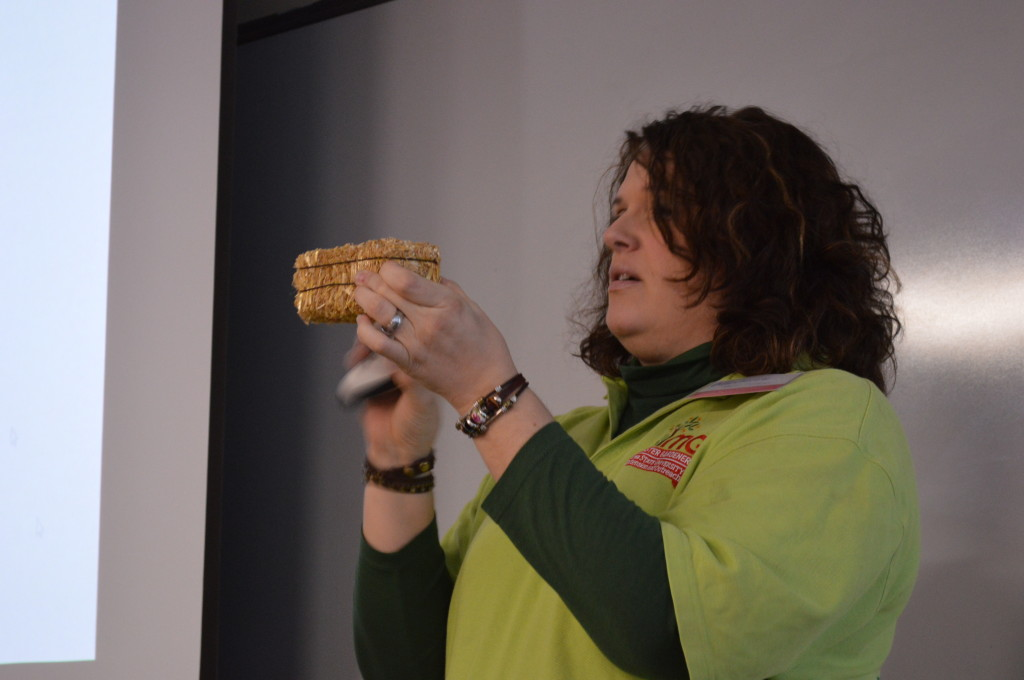 Master Gardener Melanie Brown uses a mini bale to demonstrate the process of straw bale gardening Feb. 15, 2014, during the Winter Gardening Fair. (photo/Cindy Hadish)