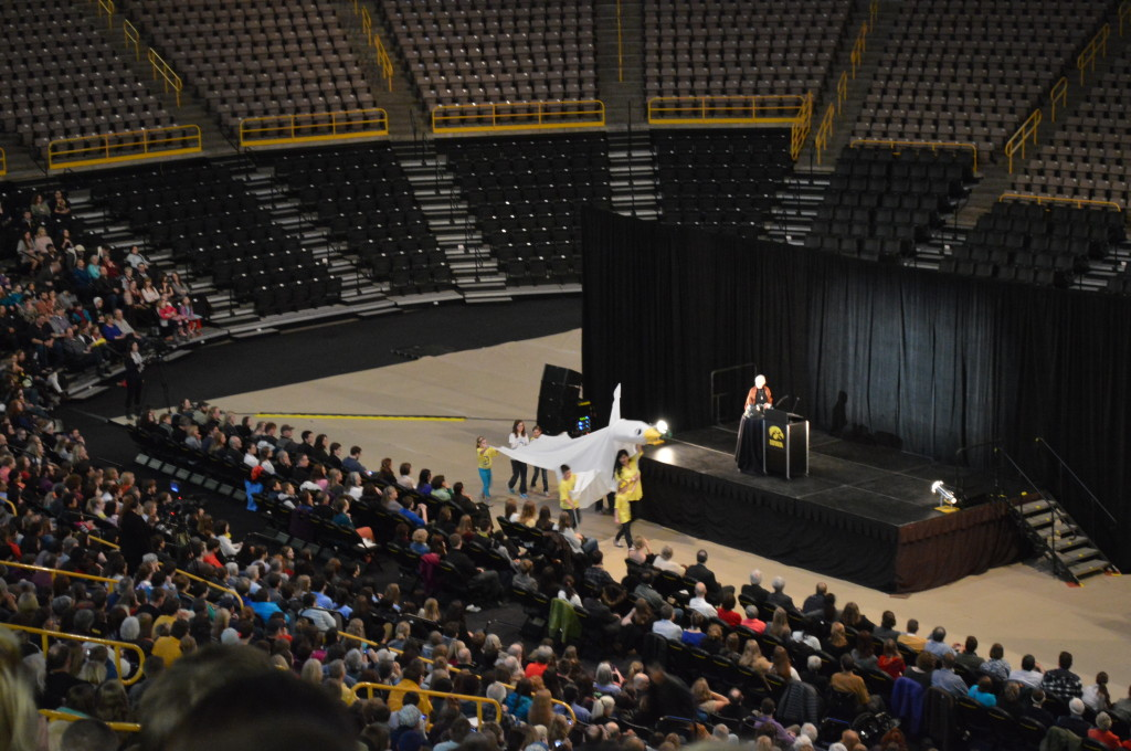 Children carrying a fabric peace dove make their way to join Jane Goodall on stage at Carver-Hawkeye Arena in Iowa City on Monday, March 10, 2014. (photo/Cindy Hadish)