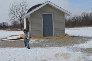 Braydon runs outside next to the family's mushroom growing operation in rural Columbus Junction. (photo/Cindy Hadish)