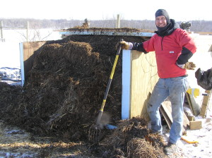 Rich Schuler is shown by the compost system. (photo/Practical Farmers of Iowa)