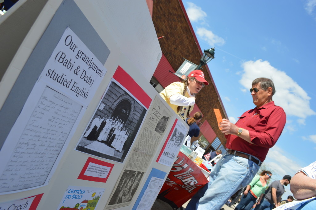 Julie Wiedner of the Czech School Board discusses Czech terminology with Denver Dvorsky of the Czech Heritage Foundation during Houby Days on 16th Avenue SW in Cedar Rapids. (photo/Cindy Hadish)