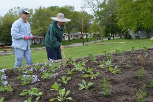 Volunteers work on a new garden bed at Noelridge Park in Cedar Rapids earlier in May. Weeding parties on Saturday mornings will keep the beds looking their best. (photo/Cindy Hadish)