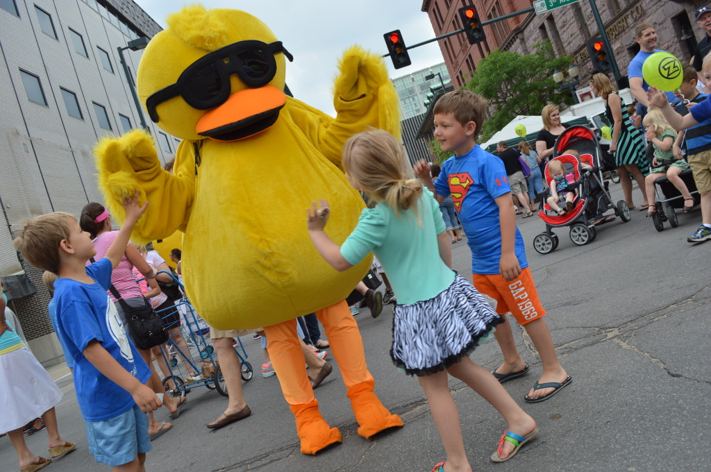 High-fives went to the costumed duck that enthralled children during the first Downtown Farmers Market of the season on June 7, 2014, in Cedar Rapids. (photo/Cindy Hadish)