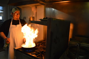 Kitchen manager Parrish Koele, prepares a fiery dish at the Ronneburg Restaurant in the Amana Colonies. (photo/Cindy Hadish)