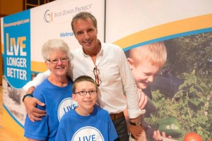Lynn Stansbery is shown with her grandson and author Dan Buettner at the Blue Zones Project Kickoff in Cedar Rapids. (photo/Blue Zones Project)