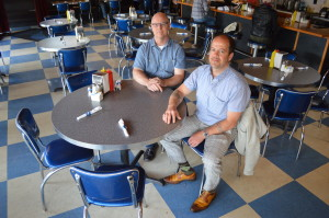 Owners Jon Wilson and Thomas Connolly are shown at the Bluebird Diner in Iowa City. The two opened the restaurant in 2008. (photo/Cindy Hadish)