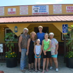 Members of the Lucina family stand in front of the market shop they've built at Northern Ridge Berry Farm, near Oxford, Iowa. (photo/Cindy Hadish)