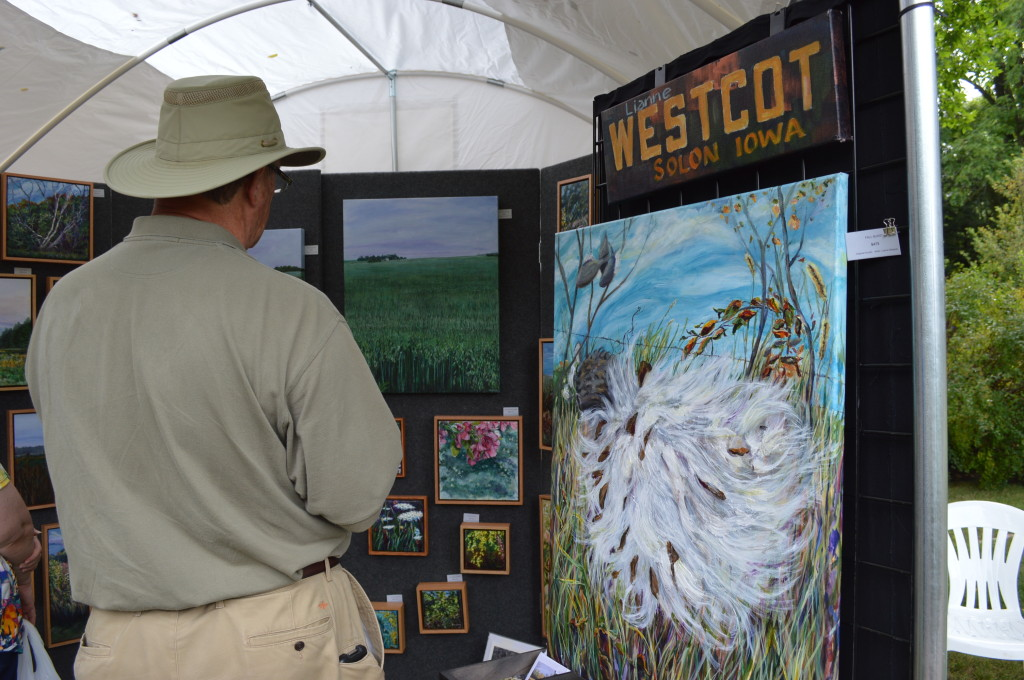 Paintings were among the art sold at the Brucemore Garden & Art Show on Saturday, Aug. 23, 2014. (photo/Cindy Hadish)