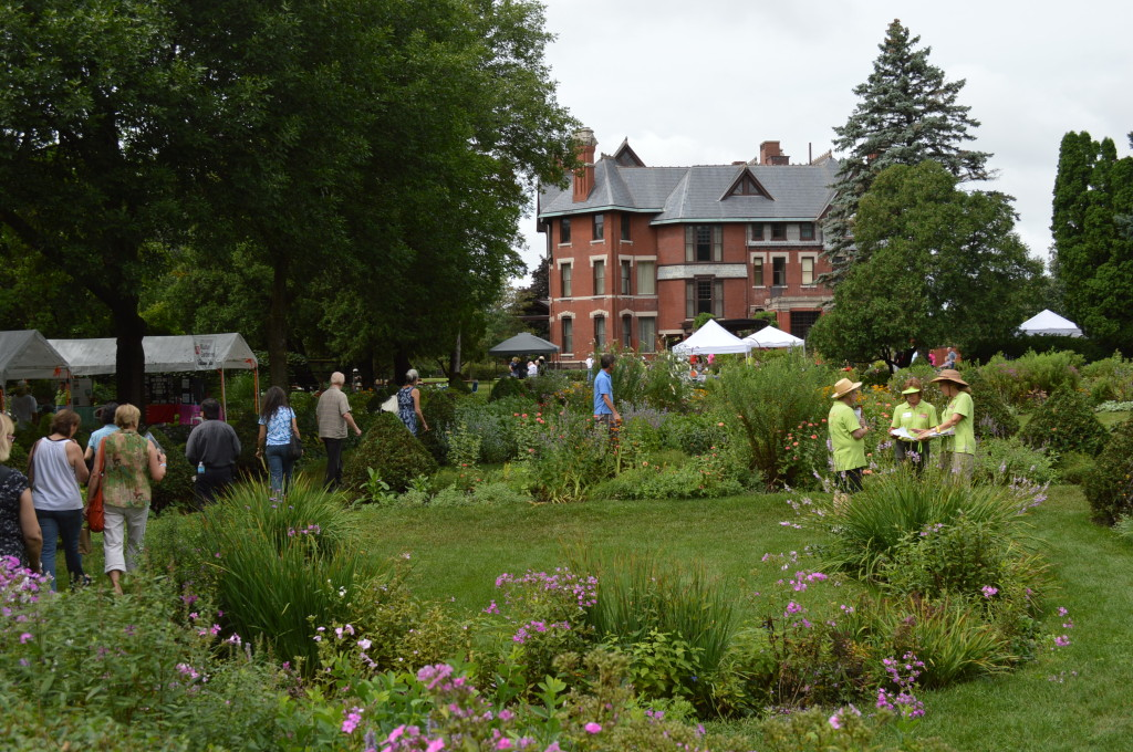 Linn County Master Gardeners and others walk through the formal gardens at Brucemore on Saturday, Aug. 23, 2014. (photo/Cindy Hadish)