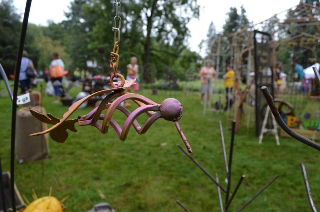 Customers shop for garden art during the Brucemore Garden & Art Show on Saturday, Aug. 23, 2014. (photo/Cindy Hadish)