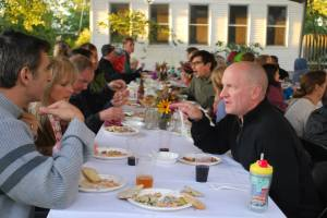 Diners enjoy a meal during last year's  Harvest Dinner during the Field to Family Local Food Festival in Iowa City. (photo/Field to Family)