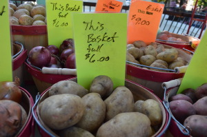 Potatoes and other vegetables are sold by the basket by Brad Alderton at the Washington, Iowa, farmers market on Sept. 18, 2014. (photo/Cindy Hadish)