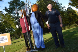 Francis Lebeda of Cedar Rapids is shown with the scarecrow display he helped to create at Brucemore in Cedar Rapids. (photo/Cindy Hadish)
