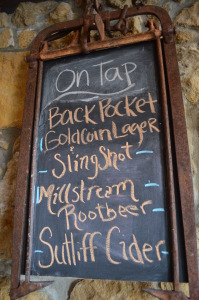 A sign notes the beverages on tap in August 2014 at Sutliff Cider in rural Lisbon. (photo/Cindy Hadish)