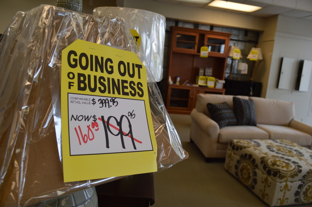 Signs note the end of business for Smulekoff's in downtown Cedar Rapids. (photo/Cindy Hadish)
