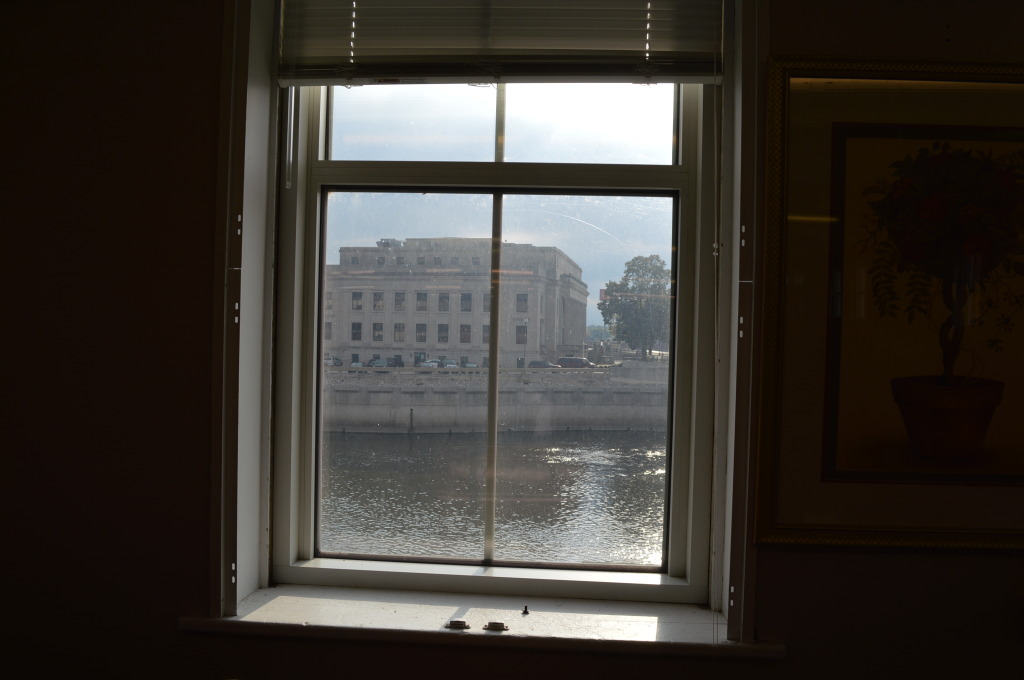 A view from an upper-floor windows shows the Cedar River, alongside Smulekoff's in downtown Cedar Rapids. (photo/Cindy Hadish)