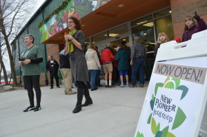 Crowds rush through the doors of New Pioneer Food Co-op on opening day. (photo/Cindy Hadish)