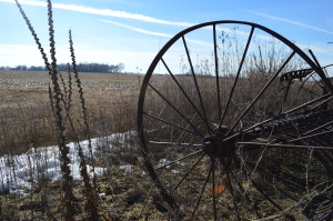 Vintage farm equipment remains near fields that are still farmed at the Johnson County Poor Farm. (photo/Cindy Hadish)