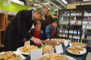 "Customers sample baked goods during a ""sneak peek"" of New Pioneer Food Co-op's Cedar Rapids store in December 2014. The store will celebrate its another grand opening in March. (photo/Cindy Hadish)"