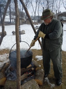 Volunteer Mike Duss of Cedar Rapids tends the pot Sunday, March 3, 2013, during the Maple Syrup Festival at the Indian Creek Nature Center in Cedar Rapids, Iowa. (photo/Cindy Hadish)