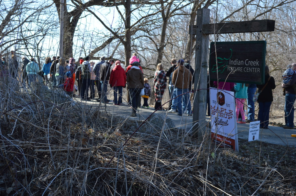 Festival-goers enjoy a sunny morning at the Indian Creek Nature Center in Cedar Rapids on Saturday, March 21, 2015. The Nature Center's Maple Syrup Festival continues on Sunday, March 22. (photo/Cindy Hadish)
