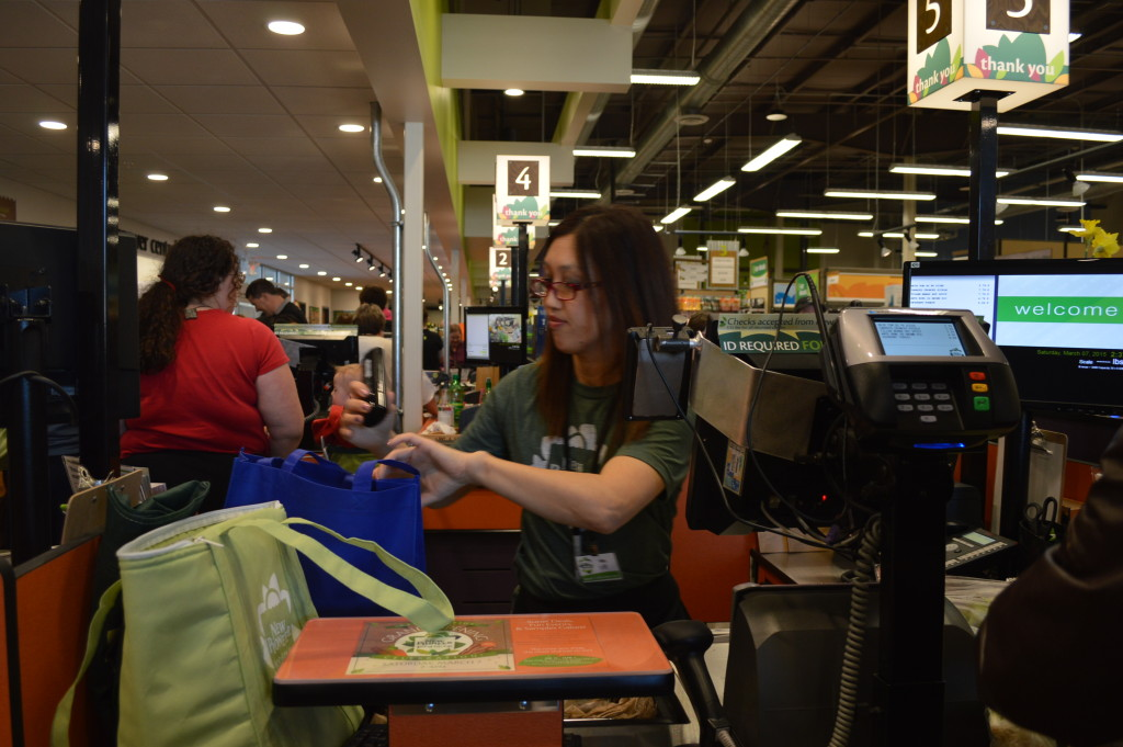 Cashiers kept busy during the grand opening of the New Pioneer Food Co-op store on March 7, 2015. (photo/Cindy Hadish)