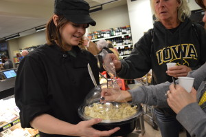 Cheese samples from Milton Creamery were a popular item during the grand opening for New Pioneer's new Cedar Rapids store. (photo/Cindy Hadish)