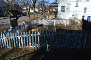 These raised beds in Wellington Heights, shown in the off-season, will soon be lush with plants chosen by residents who reserve a spot. (photo/Cindy Hadish)