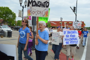 The March Against Monsanto makes its way through New Bohemia in Cedar Rapids. (photo/Cindy Hadish)